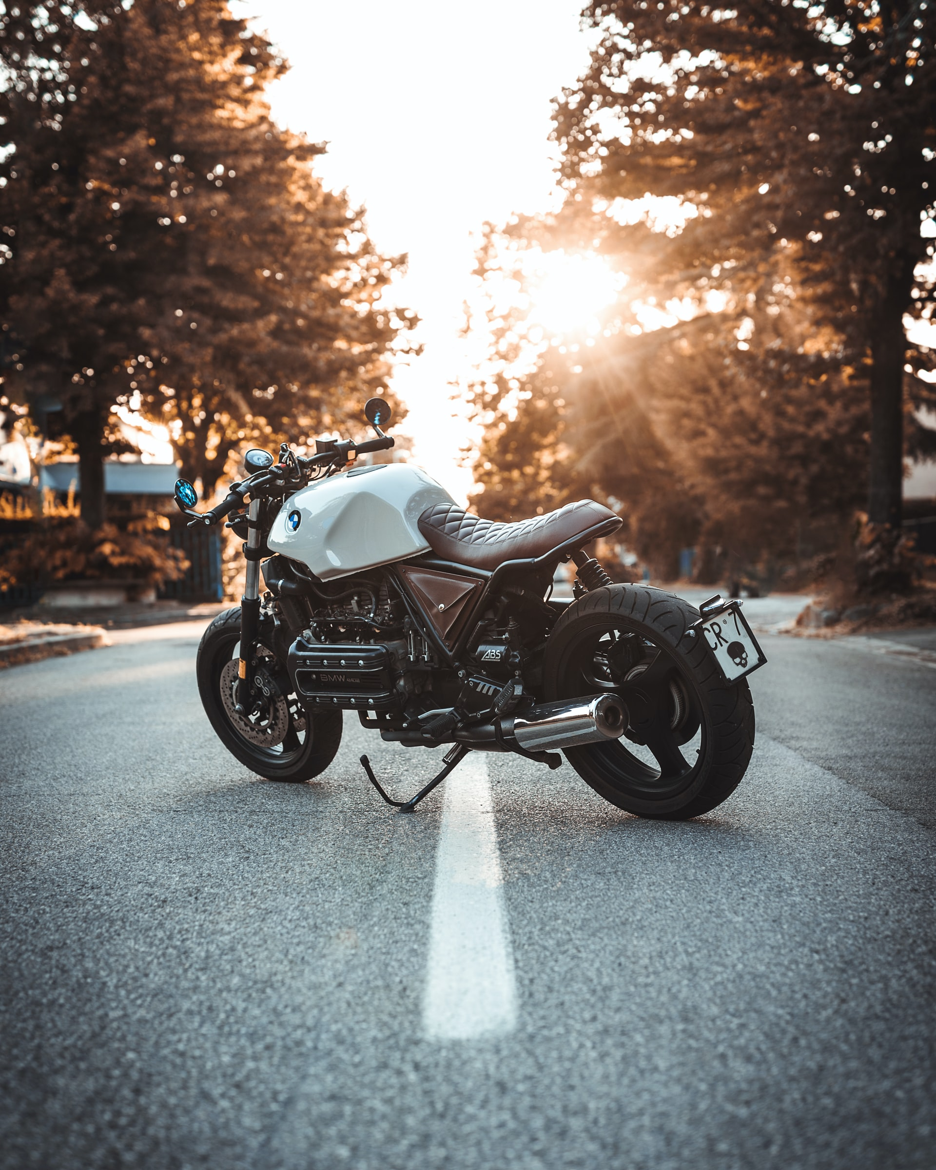 white-motorcycle-sunset